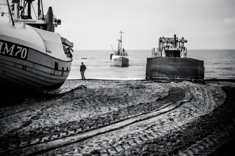 The fishing boats from Thorup are hauled up to the beach by a big ol' Caterpillar