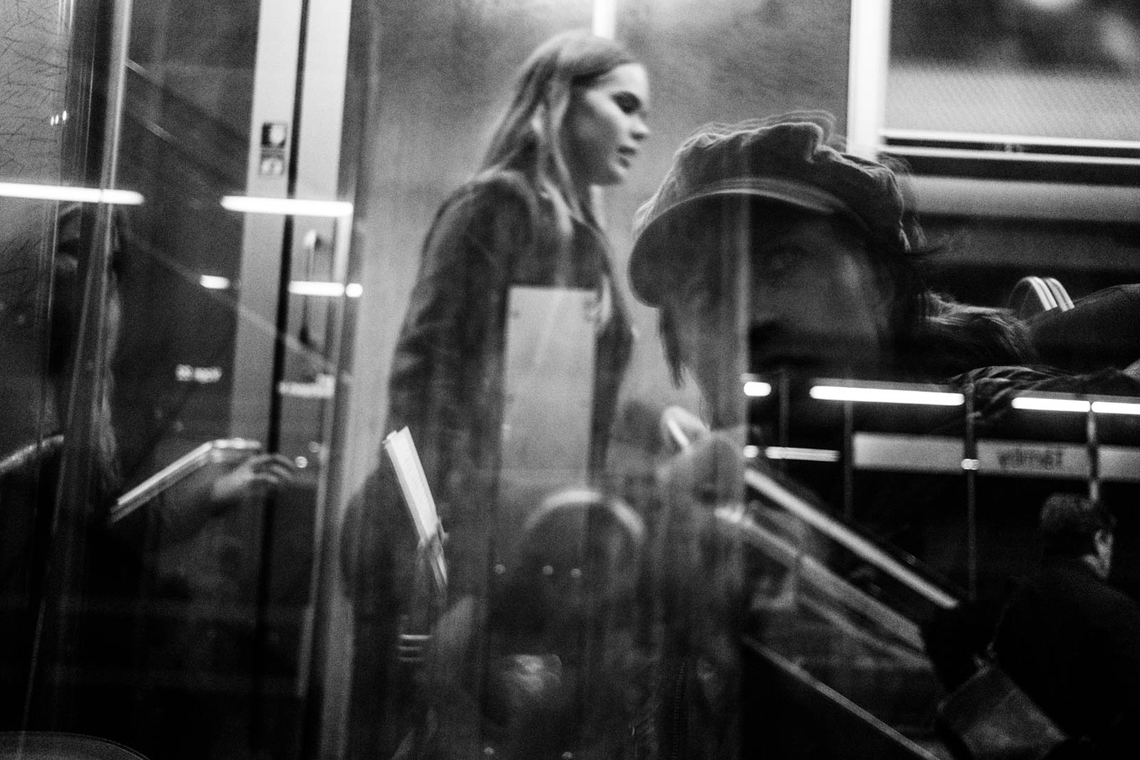 Self portrait with a stranger, on the train somewhere in Malmö, Sweden.