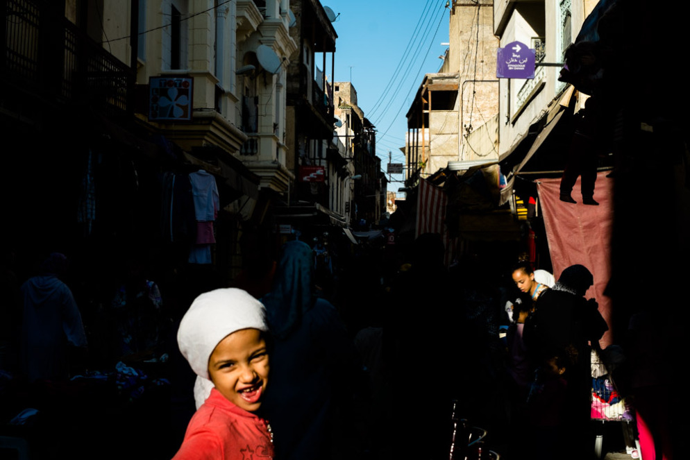 A child skips down the street in Melha. Fes, Morocco, September 2013