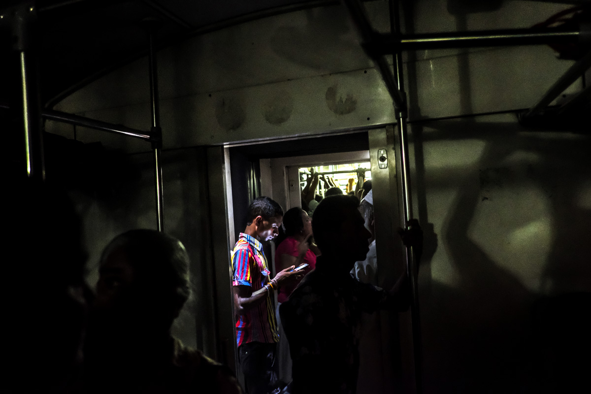 Passenger on the train. Colombo, Sri Lanka -- Fuji X-Pro 2, XF 18mm F2 | 1/19 sec, f2, ISO 10,000