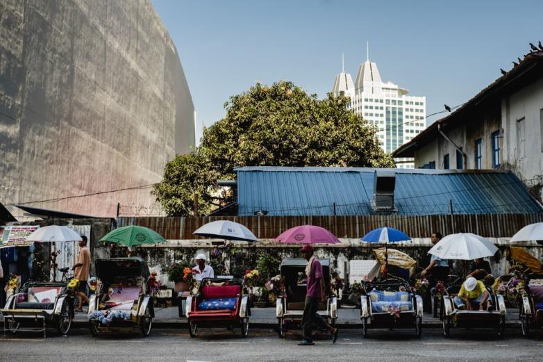 Trishaw riders gather to rest in Jalan Penang. Georgetown, Penang, Malaysia.