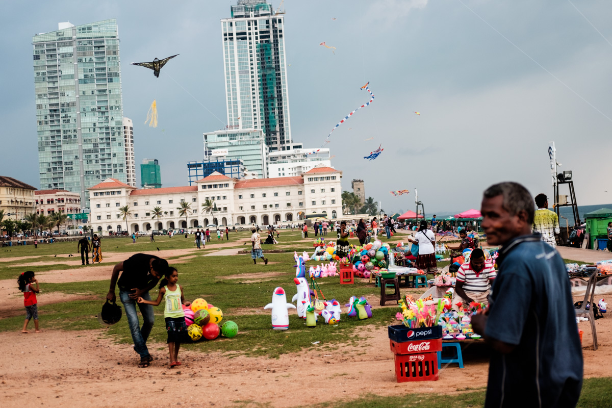 Kite sellers hawk their wares at Galle Face Green in downtown Colombo.
