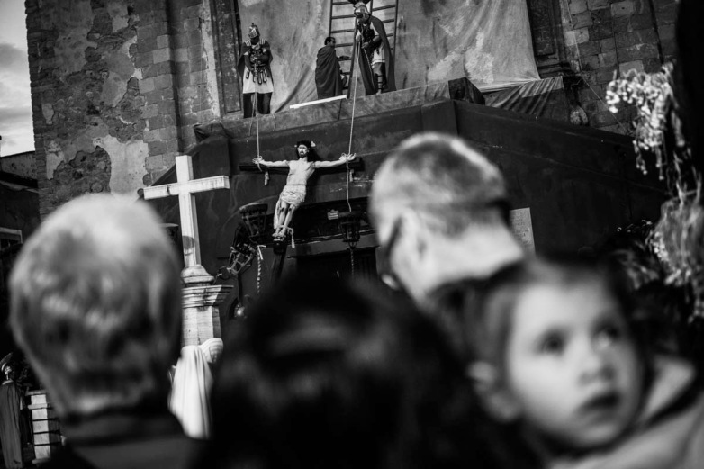 Bystanders, local and foreign alike, watch the reenactment of the crucifixion in Plaza de San Roque