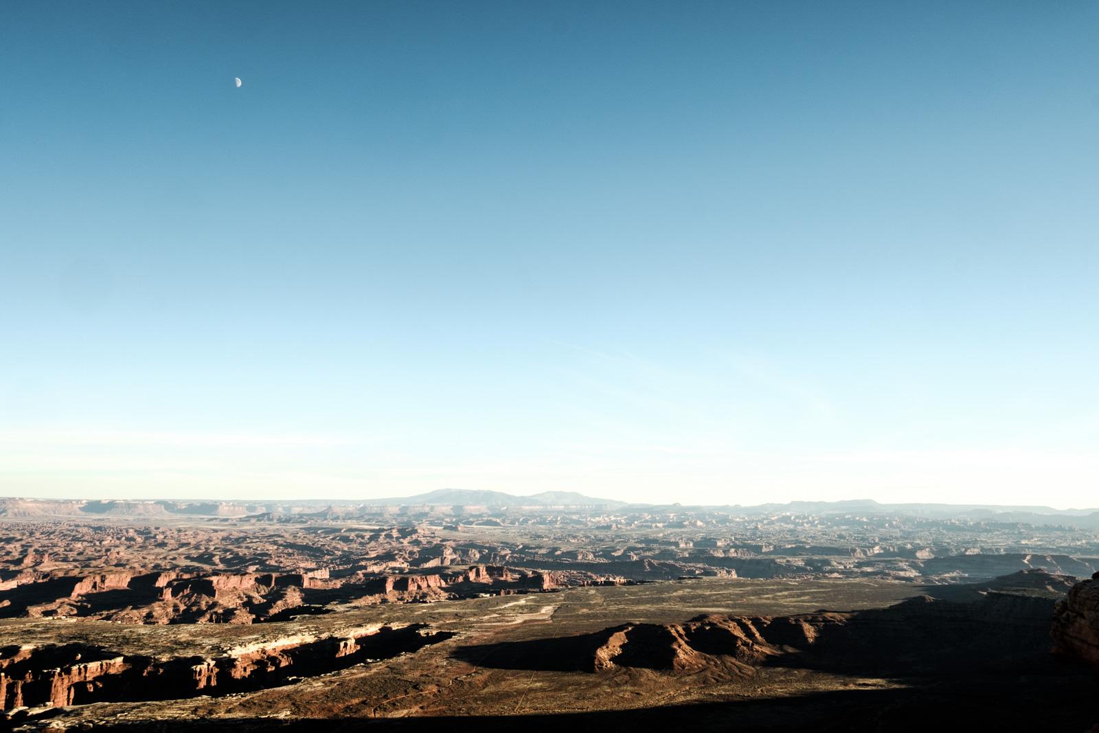 Moon over lunar surface. Canyonlands National Park, Utah