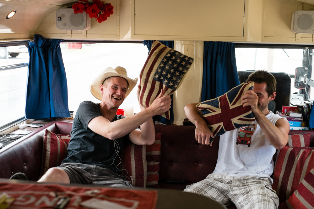 Joe (left) and Dan (right) in Doogle, the red London double-decker bus Joe had converted into a mobile home to drive across America